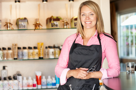 Woman salon owner in salon smiling