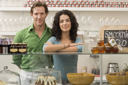 Man and woman standing behind bakery counter