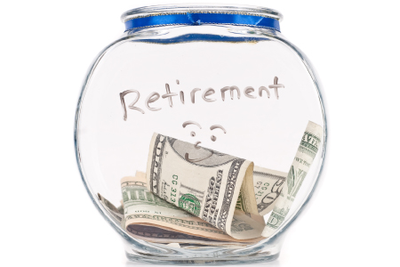 Money in jar labeled Retirement