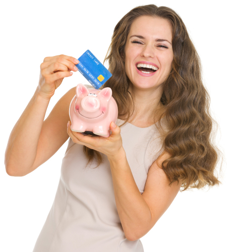 Lady smiling holding piggy bank and debit card